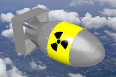 3D atomic bomb. With radioactivity sign, sky in background Stock Photo