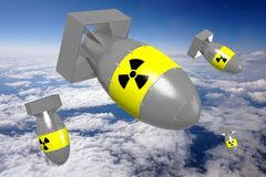 3D atomic bombs. With radioactivity signs, sky in background Royalty Free Stock Images
