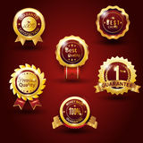 Gold guarantee badge red background Stock Images