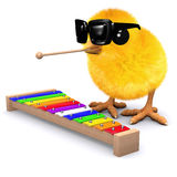 3d Baby chick plays the xylophone. 3d render of a baby chick playing a xylophone Stock Images
