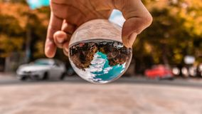 crystal ball view of Lisbon portugal ins beautiful sunny day themed as a glove with land and water. date 20 may 2019 stock image