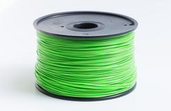 3D打印机的细丝在浅绿色反对一明亮的backgrou 免版税库存图片