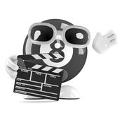 3d 8 Ball works in the movies. 3d render of an eight ball character holding a film clapperboard Stock Photos