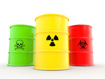 3d barrels avec le bio risque de rayonnements et les symboles matériels toxiques Images stock