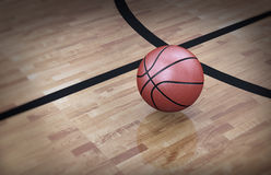 3d basketball court floor with ball. 3d illustration of an orange official ball on basketball court floor Royalty Free Stock Photo