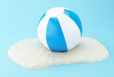 3d Beach ball on sand. 3D Illustration. Beach ball on sand. Summer concept Stock Photo