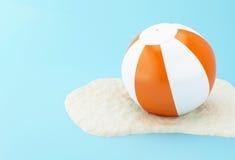 3d Beach ball on sand. 3D Illustration. Beach ball on sand. Summer concept Stock Image