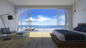 3d bedroom sea view. 3D rendering image of bed room which have day bed  and umbrella on wooden terrace, sea view, infinity swimming pool, depth of field Stock Images