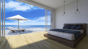 3d bedroom sea view. 3D rendering image of bed room which have day bed  and umbrella on wooden terrace, sea view, infinity swimming pool, depth of field Royalty Free Stock Image