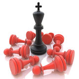 3D Black Chess King winning on Red Pawns. In the design of the information associated with winning strategy Stock Photo