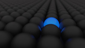 3d black matte balls. With glossy blue ball. Spheres Royalty Free Stock Photography