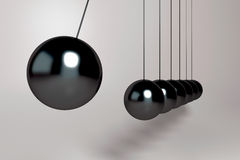 3d Pendulum balls. 3D black pendulum balls hanging from wires and light reflections Royalty Free Stock Photography