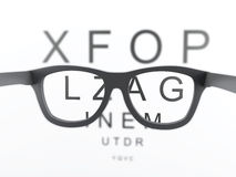 3d Black reading glasses focus on eye chart Royalty Free Stock Photo