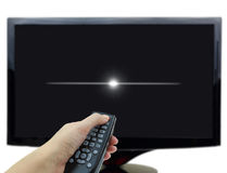 3D black tv display. With hand and remote control Royalty Free Stock Photo