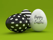 3d black and white Easter eggs lying on green. Background Royalty Free Stock Image