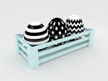 3d black and white Easter eggs in wooden box Royalty Free Stock Photos