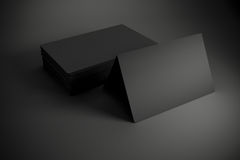 3d blank black business cards. On dark gray background Royalty Free Stock Photos