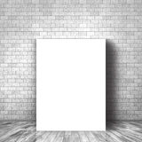 3D blank canvas leaning against a brick wall. 3D render of a blank canvas leaning against a brick wall Royalty Free Stock Photos