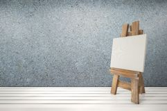 3d blank canvas with small  easel on white table Stock Images