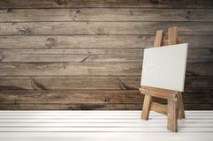 3d blank canvas with small  easel on white table Royalty Free Stock Photo