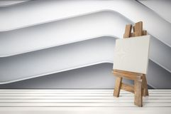 3d blank canvas with small  easel on white table Stock Image