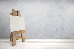 3d blank canvas with small  easel on white table Stock Photos