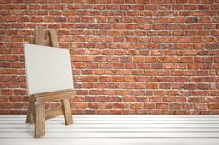 3d blank canvas with small  easel on white table Royalty Free Stock Photography