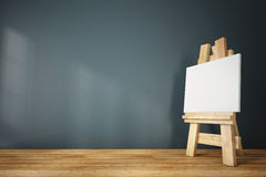 3d blank canvas with small  easel on wooden table Stock Photography