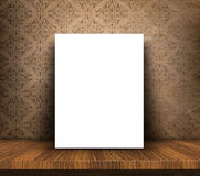 3D blank canvas on wooden table against grunge wallpaper backgro Royalty Free Stock Image