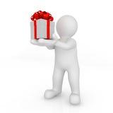 3d blank man holding gift box. Stock Photo