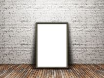 3D blank picture frame leaning against an old brick wall. 3D render of a blank picture frame leaning against an old brick wall Royalty Free Stock Photo