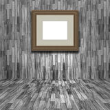 3D blank picture frame in a wooden room. 3D render of a blank picture frame in a wooden room Stock Photos