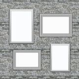 3D blank picture frames hanging on an old brick wall. 3D render of blank picture frames hanging on an old brick wall Stock Photo