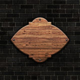 3D blank wooden sign on a brick wall. 3D render of a blank wooden sign on a brick wall Royalty Free Stock Photography