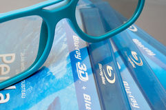 3D Blu-ray. Plastic 3D Glasses and 3D Blu-Ray Discs Royalty Free Stock Image