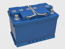 3D blue car battery with handles and gray terminals on white.  Stock Image