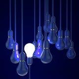 3d blue light bulb Stock Photos