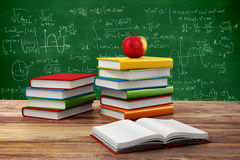3d books and apple. School background Stock Photography