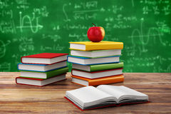3d books and apple. School background Royalty Free Stock Photo