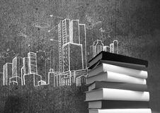 3D Books stacked by city buildings drawings Stock Images