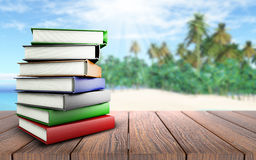 3D books on wooden table looking out to palm tree beach. 3D render of a stack of books on a wooden table looking out to a palm tree beach Stock Image