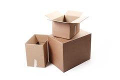 3d boxes papp frambragd bild Arkivbild
