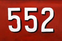 3d branco número 552 no vermelho Fotos de Stock Royalty Free