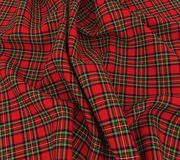 3d bright Scottish tartan plaid fabric cloth. 3d rendering of soft woollen plaid with royal stewart tartan scottish checked fabric cloth Stock Photo