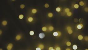 D'or, brouillé, le bokeh allume le fond Étincelles de résumé Pleine boucle de HD, 1080p banque de vidéos