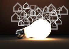 3D bulb against brown background with home icons Stock Image