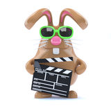 3d Bunny works in the movies. 3d render of a rabbit holding a clapperboard Stock Images