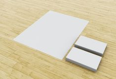 3d Business cards and blank notepads on wooden table. 3d illustration. Business cards and blank notepads on wooden table. Mock-up for branding identity Royalty Free Stock Images