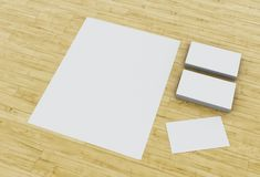3d Business cards and blank notepads on wooden table. 3d illustration. Business cards and blank notepads on wooden table. Mock-up for branding identity Stock Image