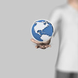 3D business man holding globe Royalty Free Stock Images